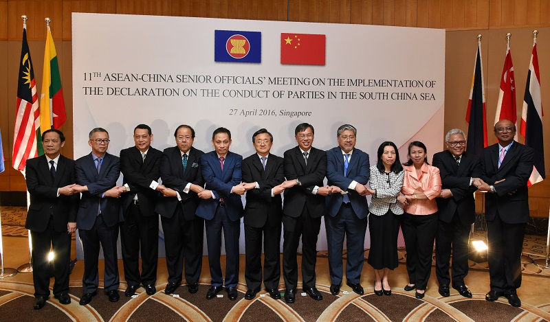 China's foreign affairs vice minister, Liu Zhenmin, (sixth from the left) poses with ASEAN delegates at an April 2016 meeting on the implementation of the 2002 Declaration on the Conduct of Parties in the South China Sea. (© ROSLAN RAHMAN/AFP/Getty Images)
