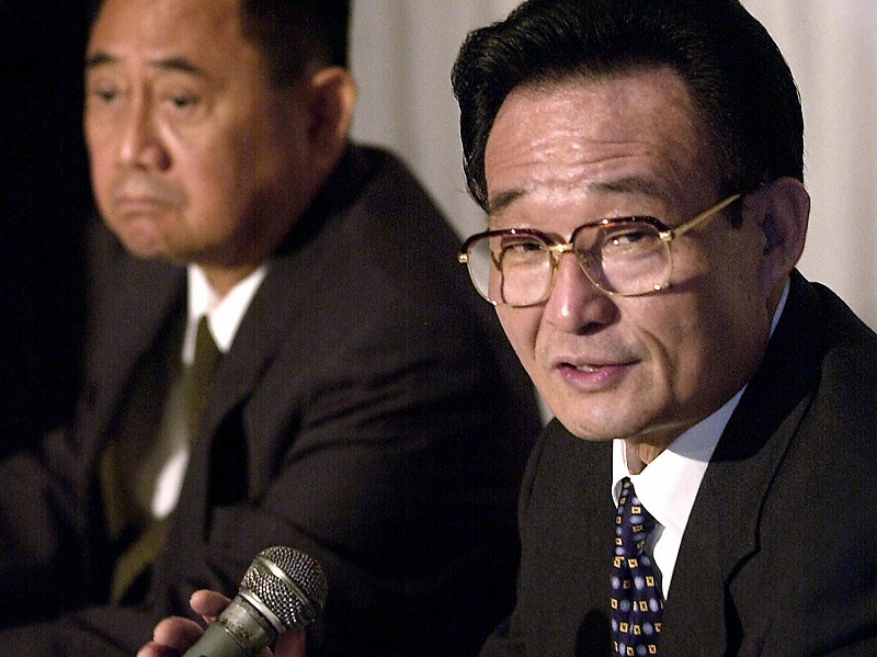 Chinese parliamentary leader Wu Bangguo speaks during an August 2003 trip to Manila. Wu discussed a joint oil exploration and development plan for the Spratly Islands. JOEL NITO/AFP/Getty Images.