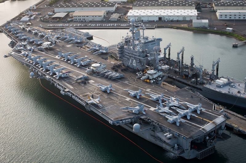 160701-N-SI773-100 JOINT BASE PEARL HARBOR-HICKHAM (July 1, 2016) An aerial view of the USS John C. Stennis (CVN 74) moored at Joint Base Pearl Harbor-Hickam for Rim of the Pacific 2016. Twenty-six nations, more than 40 ships and submarines, more than 200 aircraft, and 25,000 personnel are participating in RIMPAC from June 30 to Aug. 4, in and around the Hawaiian Islands and Southern California. The world's largest international maritime exercise, RIMPAC provides a unique training opportunity that helps participants foster and sustain the cooperative relationships that are critical to ensuring the safety of sea lanes and security on the world's oceans. RIMPAC 2016 is the 25th exercise in the series that began in 1971. (U.S. Navy Combat Camera photo by Mass Communication Specialist First Class Ace Rheaume/Released)
