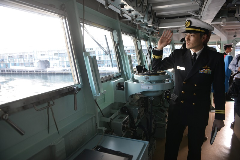 A Japanese navy officer (R) is seen on the bridge of the Japanese Asagiri-class destroyer, JDS Umigiri docked in Sydney's Naval base during a media tour on April 19, 2016. The destroyer along with the Japanese Hatsuyuki class destroyer JS Asayuki and The Soryu class stealth submarine Hakuryu are taking part in the annual bilateral Nichi Gou Trident exercise series with the Royal Australian Air Force and Royal Australian Navy from 15-26 April. / AFP / PETER PARKS (Photo credit should read PETER PARKS/AFP/Getty Images)