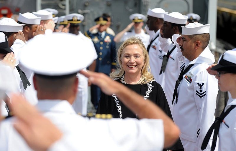 US Secretary of State Hillary Clinton (C) leaves the USS Fitzgerald, a US Navy destroyer, docked at the Manila bay, after signing a declaration marking the 60 years since the United States signed a security treaty with the Philippines on November 16, 2011. Clinton vowed military support for the Philippines, delivering a firm message from the deck of an American warship at a time of rising tensions with China. AFP PHOTO/NOEL CELIS (Photo credit should read NOEL CELIS/AFP/Getty Images)