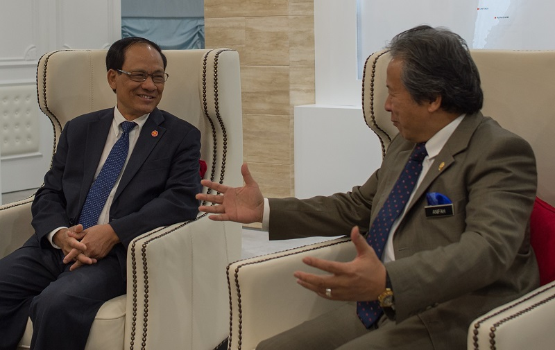 ASEAN Secretary General Le luong Minh (L) and Malaysian Foreign Minister Anifah Aman speak prior to a meeting at the foreign ministry in Putrajaya on January 7, 2015. MOHD RASFAN/AFP/Getty Images.