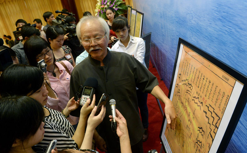 Nguyen Ta Nhi, a researcher from the Vietnam Academy of Social Sciences (VASS), introduces reporters to documents from the 17 and 18th centuries associated with Vietnam's claim to sovereignty over the Paracel islands, June 3, 2014, in Hanoi. HOANG DINH NAM/AFP/Getty Images.