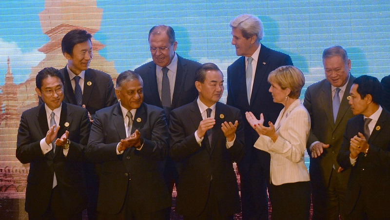 Foreign ministers preparing for a group photo during the East Asia Foreign Ministers' meeting on the sidelines of the Association of Southeast Asian Nations (ASEAN) annual ministerial meeting, being held in Vientiane on July 26, 2016. HOANG DINH NAM/AFP/Getty Images.