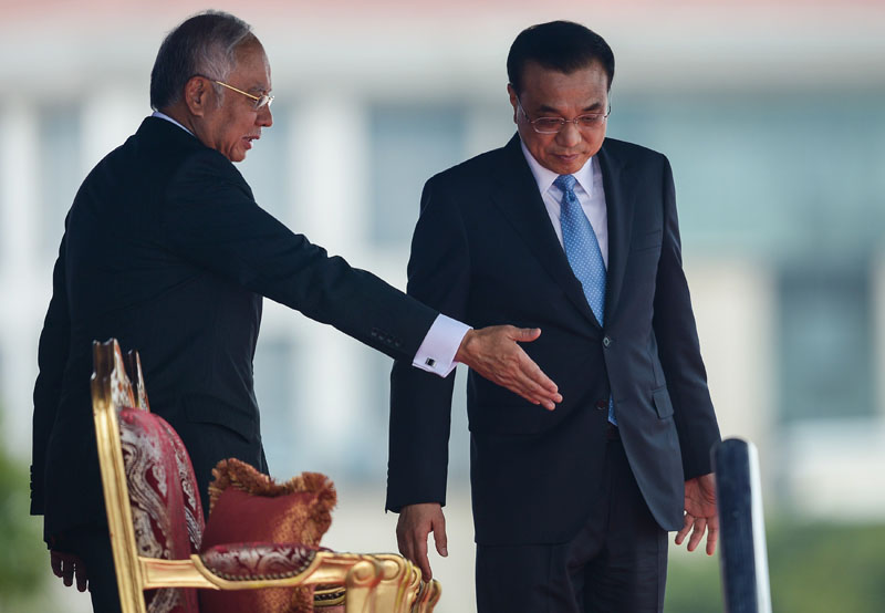 Malaysia's Prime Minister Najib Razak gestures to China's Premier Li Keqiang during a meeting in Putrajaya on November 23, 2015. MOHD RASFAN/AFP/Getty Images.