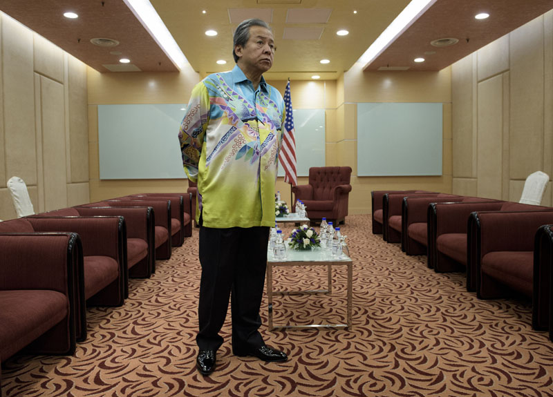 Malaysia's Foreign Minister Anifah Aman waits for US Secretary of State John Kerry before a bilateral meeting in Kuala Lumpur on August 5, 2015 . BRENDAN SMIALOWSKI/AFP/Getty Images.