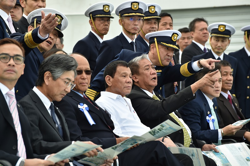 Philippine President Rodrigo Duterte (fourth from left) and other officials inspect drills conducted by the Japan Coast Guard in Yokohama on October 27, 2016. KAZUHIRO NOGI/AFP/Getty Images.