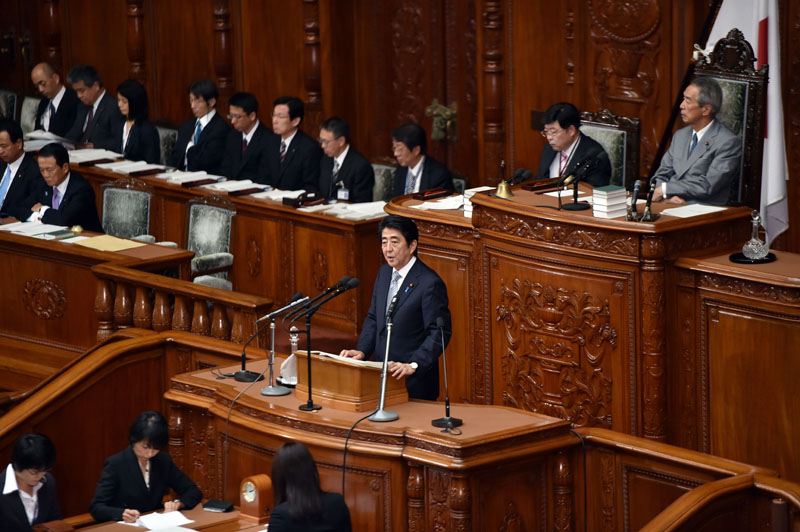 Japan's Prime Minister Shinzo Abe delivers his policy speech to the Lower House of the National Diet in Tokyo on September 29, 2014. YOSHIKAZU TSUNO/AFP/Getty Images.