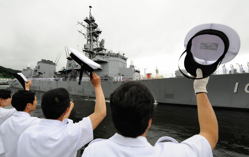 Officers of Japan's Maritime Self-Defence Force at the Yokosuka base, Kanagawa prefecture, see off the destroyer Harusame on July 6, 2009, as the ship begins a deployment in the Gulf of Aden. TORU YAMANAKA/AFP/Getty Images.